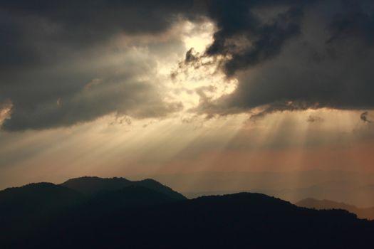 Sunbeam and mountain layer