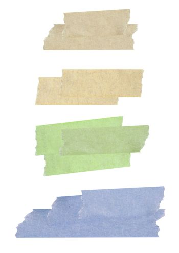 Collection of different stripes of masking tapes on white backgr