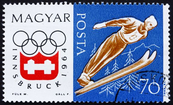 HUNGARY - CIRCA 1963: a stamp printed in the Hungary shows Ski Jumping, Winter Olympic sports, Innsbruck 64, circa 1963