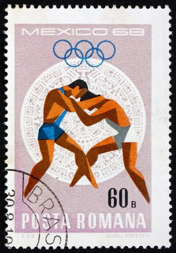 ROMANIA - CIRCA 1968: a stamp printed in the Romania shows Wrestling, Summer Olympic sports, Mexico 68, circa 1968