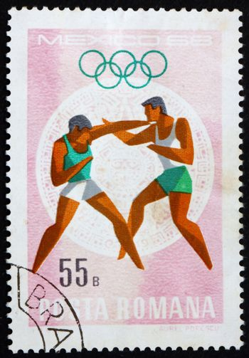 ROMANIA - CIRCA 1968: a stamp printed in the Romania shows Boxing, Summer Olympic sports, Mexico 68, circa 1968