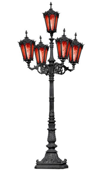 The old cast iron lamp post with red glass isolated on white background