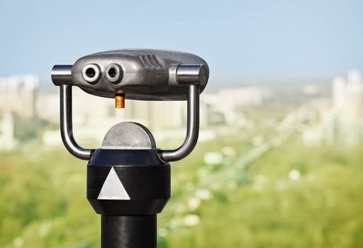 Binoculars to observe green city from a height