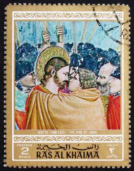 RAS AL-KHAIMAH - CIRCA 1970: a stamp printed in the Ras al-Khaimah shows The Kiss of Judas, Painting by Giotto di Bondone, Life of Jesus Christ, circa 1970