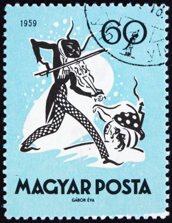 HUNGARY - CIRCA 1959: a stamp printed in the Hungary shows The Cricket and the Ant, Fairy Tale, circa 1959