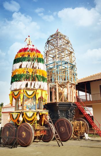 Traditional holly chariot with wooden wheels in the Indian religious temple. Preparation for Vishnu festival. India, Goa