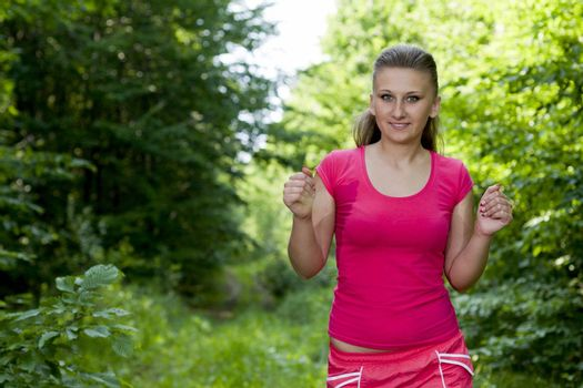 beautiful, young girl jogging in the woods