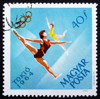 HUNGARY - CIRCA 1964: a stamp printed in the Hungary shows Women�s Gymnastics, Floor Exercise, Summer Olympic sports, Tokyo 64, circa 1964