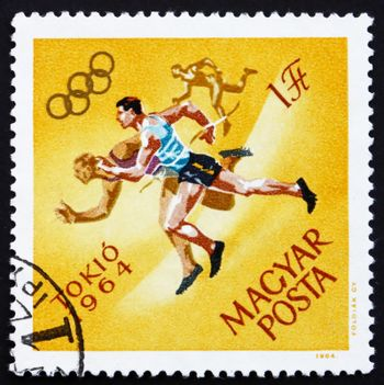 HUNGARY - CIRCA 1964: a stamp printed in the Hungary shows Running, Summer Olympic sports, Tokyo 64, circa 1964