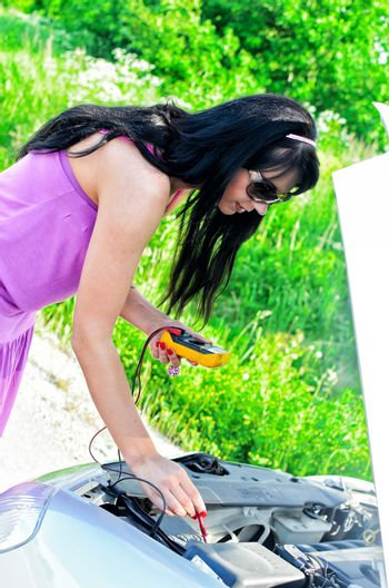 Woman controsl lead�acid battery charge with voltmeter