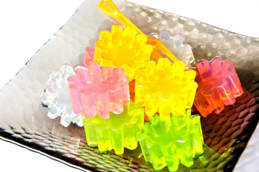 closeup of gelatin of different colors on a dish.