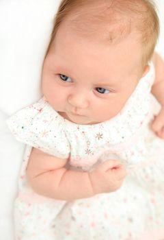 Little cute baby girl wearing a dress