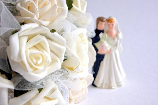 Wedding decoration - white roses bouquet, rings, bride and groom