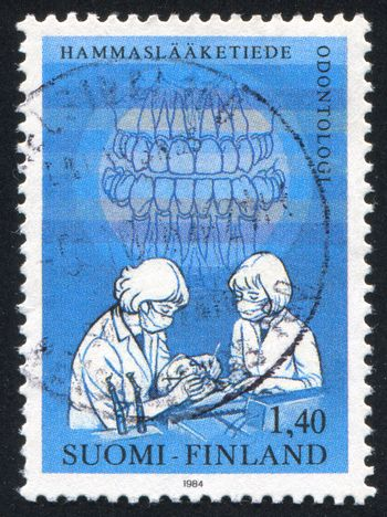 FINLAND - CIRCA 1984: stamp printed by Finland, shows Dentists Examining Patient, circa 1984