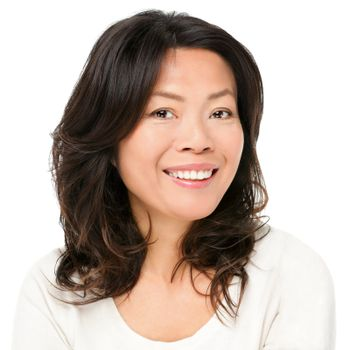 Asian woman smiling happy portrait. Beautiful mature middle aged Chinese Asian woman closeup beauty portrait isolated on white background.