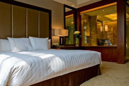 Bedroom of a elegant 5 star hotel suite room and attached marbel bathroom