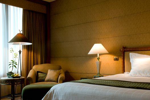 Bedroom of a elegant 5 star luxury hotel suite room