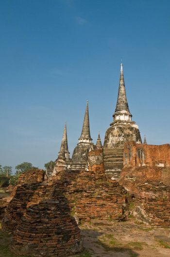 Stupas (chedis) of a Wat in Ayutthaya, Thailand. Ayutthaya city is the capital of Ayutthaya province in Thailand. Its historical park is a UNESCO world heritage.