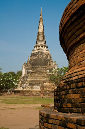 Stupa (chedi) of a Wat in Ayutthaya, Thailand. Ayutthaya city is the capital of Ayutthaya province in Thailand. Its historical park is a UNESCO world heritage.
