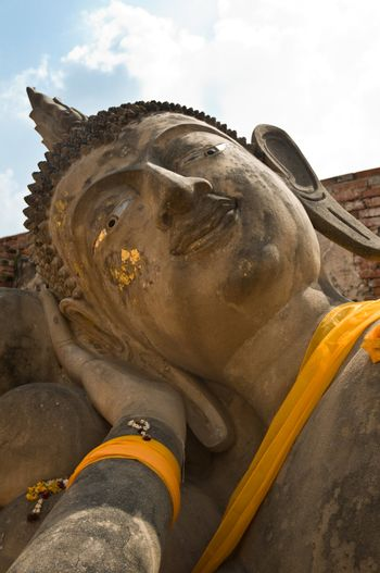 Face of a reclining Buddha. Ayutthaya city is the capital of Ayutthaya province in Thailand. Its historical park is a UNESCO world heritage.