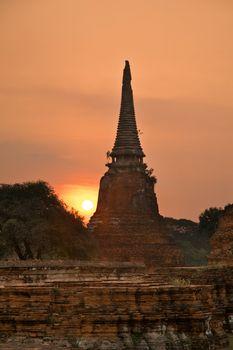 Stupa (chedi) of a Wat in Ayutthaya, Thailand, during sun set
