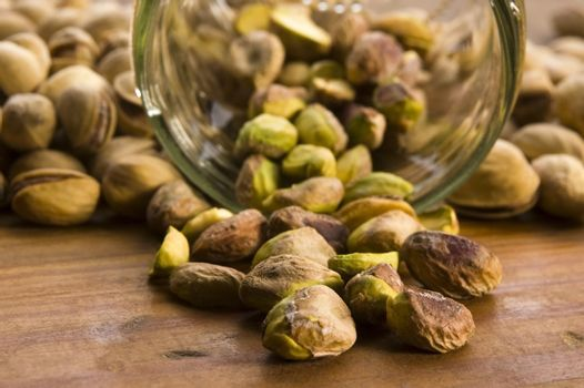 Roasted pistachios on natural wooden table