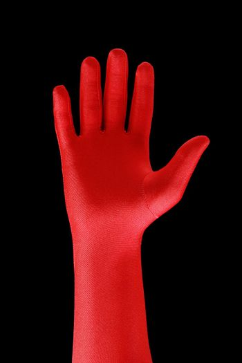 Strange hand with a red glove
