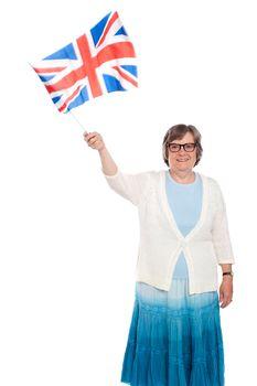 Senior lady holding UK flag and waving