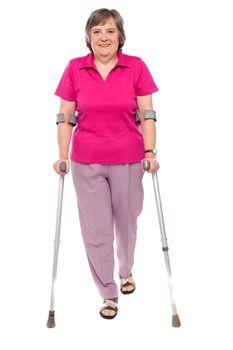 Full length portrait of an injured senior woman