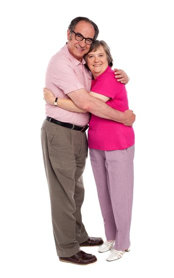 Happy aged woman hugging her husband