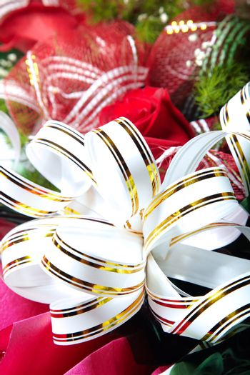 Holiday white ribbon on the bunch of flowers