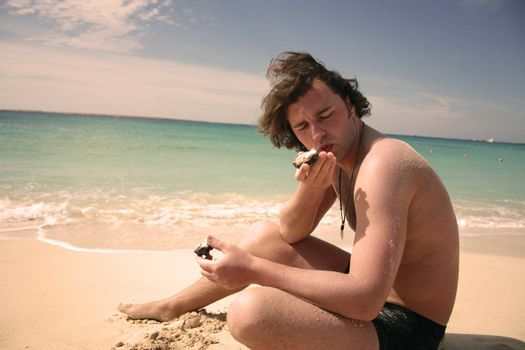 man eating on the beach on vacation