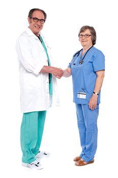 Senior medical persons shaking hands