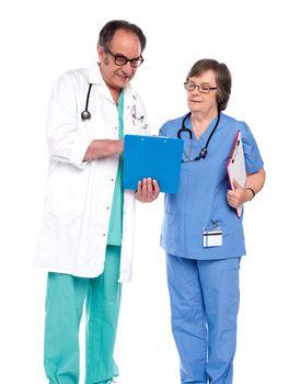 Doctors discussing a medical report