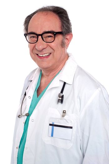 Matured male surgeon with stethoscope