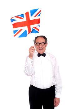 Man cheering for United Kingdom. Waving flag