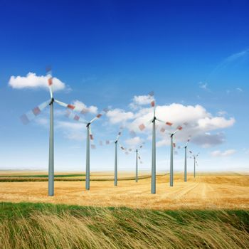 Wind turbine generate electricity on a sunny day