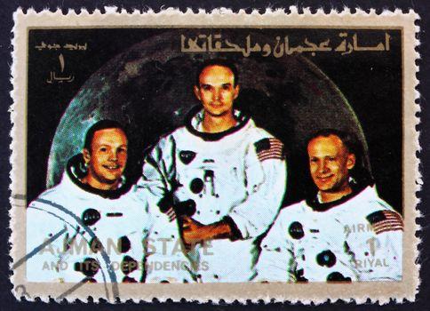 AJMAN - CIRCA 1973: a stamp printed in the Ajman shows Crew of Apollo 11, Neil Armstrong, Buzz Aldrin and Michael Collins, Moon-landing, Apollo 11, circa 1973