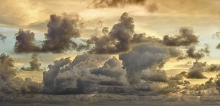 Dark storm clouds in evening sky - panorama