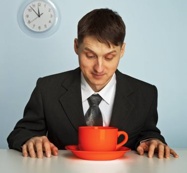 Businessman going to drink a very strong and very hot coffee