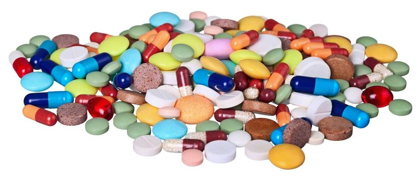 A large pile of medical pills isolated on white background