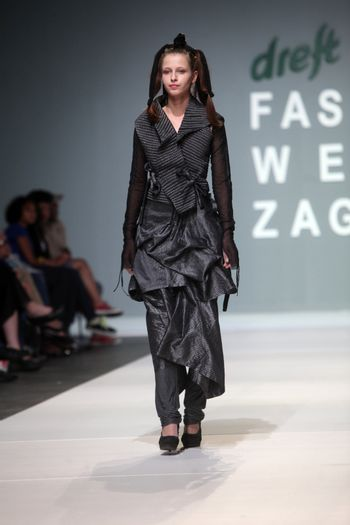 "ZAGREB, CROATIA - MAY 12: Fashion model wears clothes made by Milena Rogulj on ""ZAGREB FASHION WEEK"" show on May 12, 2012 in Zagreb, Croatia."