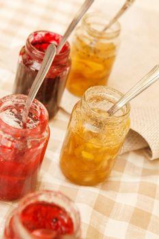 different jars full of fruity jam
