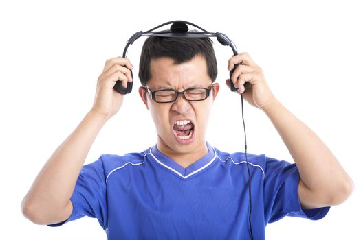 Young man expressing loud sound