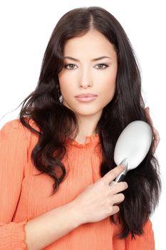 pretty woman combing her long black hair