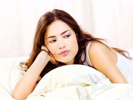 woman lie in bed at home