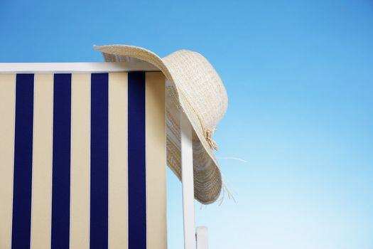 straw hat in a beach chair