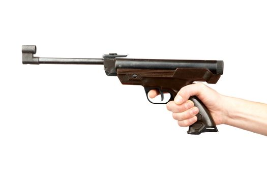The man's hand holds pneumatic pistol