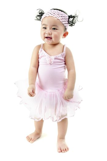 One year old pan Asian baby girl learn walking on her own