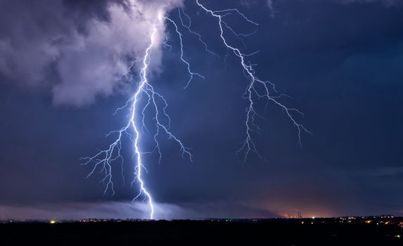 Big lightning in the stormy sky over a city